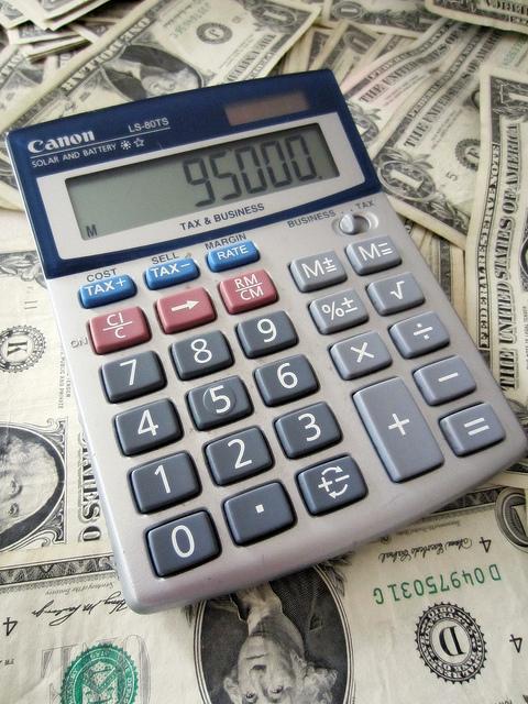 Calculator on dollar bills