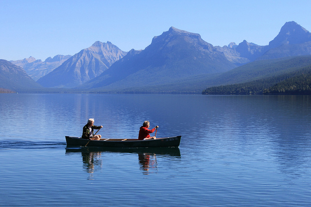 Couple Rowing on Lake