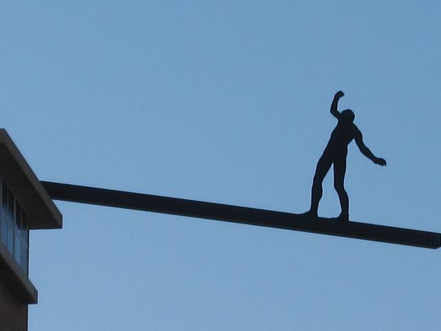 Man balancing on plank