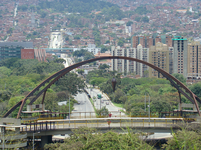 Bridge in Medellin. The plumb bob in the middle supposedly marks the center of the city.